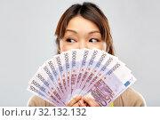 Купить «asian woman with hundreds of euro money banknotes», фото № 32132132, снято 11 мая 2019 г. (c) Syda Productions / Фотобанк Лори