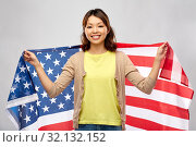 Купить «happy asian woman with american flag», фото № 32132152, снято 11 мая 2019 г. (c) Syda Productions / Фотобанк Лори