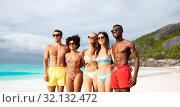 Купить «happy friends in swimwear hugging on summer beach», фото № 32132472, снято 29 июля 2018 г. (c) Syda Productions / Фотобанк Лори