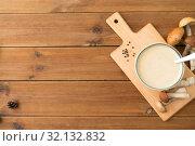 Купить «mushroom cream soup in bowl on cutting board», фото № 32132832, снято 13 сентября 2018 г. (c) Syda Productions / Фотобанк Лори
