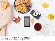 Купить «smartphone, tea, camera, cookies and autumn leaves», фото № 32132908, снято 26 октября 2018 г. (c) Syda Productions / Фотобанк Лори