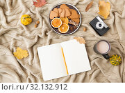 Купить «notebook, hot chocolate, camera and autumn leaves», фото № 32132912, снято 26 октября 2018 г. (c) Syda Productions / Фотобанк Лори