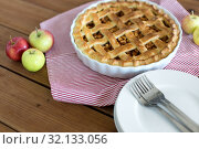 Купить «apple pie in baking mold on wooden table», фото № 32133056, снято 23 августа 2018 г. (c) Syda Productions / Фотобанк Лори