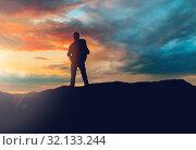 Купить «traveller standing on edge of hill over sunset», фото № 32133244, снято 31 августа 2014 г. (c) Syda Productions / Фотобанк Лори