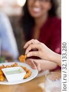 Купить «hand with snack and dip sauce at restaurant», фото № 32133280, снято 2 мая 2017 г. (c) Syda Productions / Фотобанк Лори