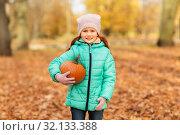 Купить «happy little girl with pumpkin at autumn park», фото № 32133388, снято 21 октября 2018 г. (c) Syda Productions / Фотобанк Лори