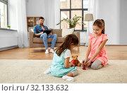 Купить «girls playing with toy crockery and teddy at home», фото № 32133632, снято 31 марта 2019 г. (c) Syda Productions / Фотобанк Лори