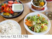 Купить «vegetable salad in bowl at indian restaurant», фото № 32133748, снято 2 мая 2017 г. (c) Syda Productions / Фотобанк Лори