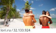 Купить «happy friends or couples hugging on summer beach», фото № 32133924, снято 29 июля 2018 г. (c) Syda Productions / Фотобанк Лори