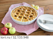 Купить «apple pie in baking mold on wooden table», фото № 32133948, снято 23 августа 2018 г. (c) Syda Productions / Фотобанк Лори
