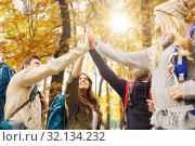 Купить «friends making high five on hike in autumn», фото № 32134232, снято 31 августа 2014 г. (c) Syda Productions / Фотобанк Лори