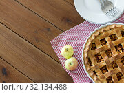 Купить «apple pie in baking mold on wooden table», фото № 32134488, снято 23 августа 2018 г. (c) Syda Productions / Фотобанк Лори