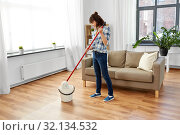Купить «woman or housewife with mop cleaning floor at home», фото № 32134532, снято 13 апреля 2019 г. (c) Syda Productions / Фотобанк Лори