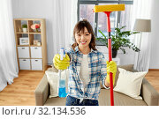 Купить «asian woman with window cleaner and sponge mop», фото № 32134536, снято 13 апреля 2019 г. (c) Syda Productions / Фотобанк Лори