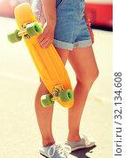Купить «teenage girl with skateboard on city street», фото № 32134608, снято 19 июля 2016 г. (c) Syda Productions / Фотобанк Лори