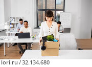 Купить «happy businesswoman with personal stuff at office», фото № 32134680, снято 23 марта 2019 г. (c) Syda Productions / Фотобанк Лори