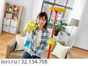 Купить «asian woman with window cleaner and sponge mop», фото № 32134708, снято 13 апреля 2019 г. (c) Syda Productions / Фотобанк Лори