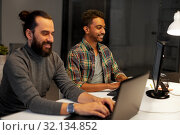 Купить «creative team with computer working late at office», фото № 32134852, снято 24 января 2018 г. (c) Syda Productions / Фотобанк Лори