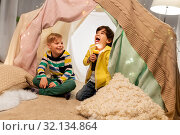 Купить «happy boys with torch light in kids tent at home», фото № 32134864, снято 18 февраля 2018 г. (c) Syda Productions / Фотобанк Лори