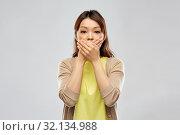 Купить «scared asian woman over grey background», фото № 32134988, снято 11 мая 2019 г. (c) Syda Productions / Фотобанк Лори