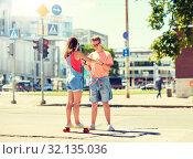 Купить «teenage couple riding skateboards on city street», фото № 32135036, снято 19 июля 2016 г. (c) Syda Productions / Фотобанк Лори