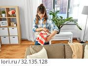 Купить «asian woman picking dirty laundry at home», фото № 32135128, снято 13 апреля 2019 г. (c) Syda Productions / Фотобанк Лори