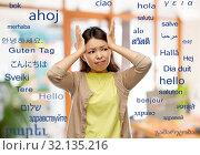 Купить «stressed asian woman holding to her head», фото № 32135216, снято 11 мая 2019 г. (c) Syda Productions / Фотобанк Лори