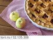 Купить «apple pie in baking mold on wooden table», фото № 32135308, снято 23 августа 2018 г. (c) Syda Productions / Фотобанк Лори