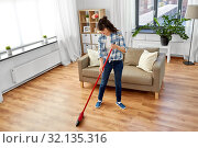 Купить «asian woman with broom sweeping floor and cleaning», фото № 32135316, снято 13 апреля 2019 г. (c) Syda Productions / Фотобанк Лори