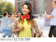 Купить «happy asian woman with bow tie over rooftop party», фото № 32135588, снято 11 мая 2019 г. (c) Syda Productions / Фотобанк Лори