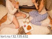Купить «women with hot chocolate eating waffles at home», фото № 32135632, снято 21 января 2018 г. (c) Syda Productions / Фотобанк Лори