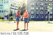 Купить «teenage couple riding skateboards on city street», фото № 32135728, снято 19 июля 2016 г. (c) Syda Productions / Фотобанк Лори