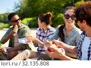 Купить «happy friends having picnic on lake pier in summer», фото № 32135808, снято 15 июня 2019 г. (c) Syda Productions / Фотобанк Лори