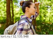 Купить «happy asian woman with backpack hiking in forest», фото № 32135948, снято 15 июня 2019 г. (c) Syda Productions / Фотобанк Лори