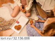 Купить «women drinking hot chocolate and eating waffles», фото № 32136008, снято 21 января 2018 г. (c) Syda Productions / Фотобанк Лори