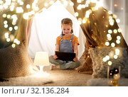 Купить «little girl with tablet pc in kids tent at home», фото № 32136284, снято 27 января 2018 г. (c) Syda Productions / Фотобанк Лори
