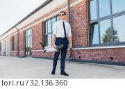 Купить «businessman with folding scooter on rooftop», фото № 32136360, снято 1 августа 2019 г. (c) Syda Productions / Фотобанк Лори
