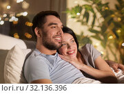 Купить «happy couple watching tv in bed at night at home», фото № 32136396, снято 27 января 2018 г. (c) Syda Productions / Фотобанк Лори