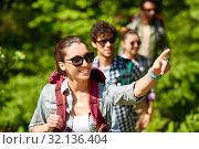 Купить «group of friends with backpacks hiking in forest», фото № 32136404, снято 15 июня 2019 г. (c) Syda Productions / Фотобанк Лори