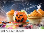 Купить «halloween party cupcakes and candies on table», фото № 32136660, снято 6 июля 2017 г. (c) Syda Productions / Фотобанк Лори