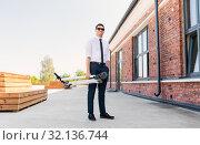 Купить «businessman with folding scooter on rooftop», фото № 32136744, снято 1 августа 2019 г. (c) Syda Productions / Фотобанк Лори