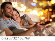 Купить «happy couple watching tv in bed at night at home», фото № 32136768, снято 27 января 2018 г. (c) Syda Productions / Фотобанк Лори