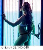 At solarium. Image of sexy woman with perfect body. Стоковое фото, фотограф Гурьянов Андрей / Фотобанк Лори