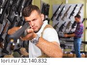 Купить «Men choosing air weapon», фото № 32140832, снято 4 июля 2017 г. (c) Яков Филимонов / Фотобанк Лори