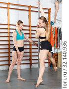 Купить «Pole dancers assisting each other on pylon», фото № 32140936, снято 10 мая 2018 г. (c) Яков Филимонов / Фотобанк Лори