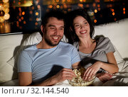 Купить «couple with popcorn watching tv at night at home», фото № 32144540, снято 27 января 2018 г. (c) Syda Productions / Фотобанк Лори