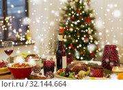 Купить «food and drinks on christmas table at home», фото № 32144664, снято 17 декабря 2017 г. (c) Syda Productions / Фотобанк Лори