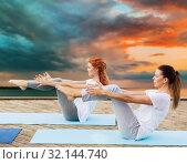 Купить «women making yoga in half-boat pose outdoors», фото № 32144740, снято 7 августа 2016 г. (c) Syda Productions / Фотобанк Лори