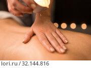 Купить «back massage with hot oil candle at spa», фото № 32144816, снято 26 января 2017 г. (c) Syda Productions / Фотобанк Лори
