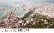 Купить «Panoramic view of Mediterranean coastal city of Malaga with harbor, Spain», видеоролик № 32145344, снято 18 апреля 2019 г. (c) Яков Филимонов / Фотобанк Лори
